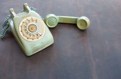 Old phone on leather Stock Images