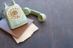 Old phone and old paper on leather Stock Image