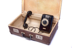Old phone in old suitcase Royalty Free Stock Photo