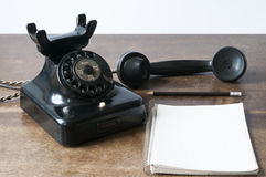 Old phone with pad and pencil Royalty Free Stock Photography