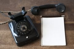 Old phone with pad and pencil Stock Photos