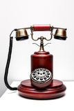 Old phone. Red gold Royalty Free Stock Photos