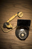 Old phone replaced by current technology. Details royalty free stock image
