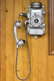 Old phone, retro, old phone. Hanging on a wooden wall royalty free stock images