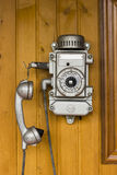 Old phone, retro, old phone. Hanging on a wooden wall royalty free stock photo