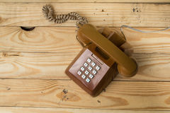 Old phone retro. Placed on a wooden floor royalty free stock image
