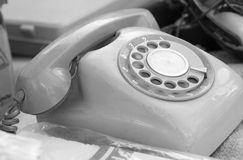 Old phone vintage style for sale. Royalty Free Stock Photography