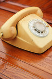 Old phone vintage style on the wooden floor. Stock Image