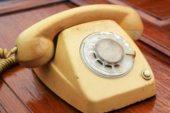 Old phone vintage style on the wooden floor. Stock Photos