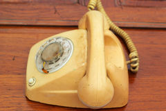 Old phone vintage style on the wooden floor. Royalty Free Stock Photography