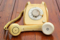 Old phone vintage style on the wooden floor. Stock Photography