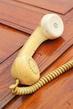 Old phone vintage style on the wooden floor. Royalty Free Stock Photo