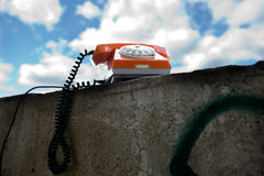Old phone on the wall Royalty Free Stock Images