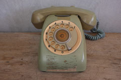 Old phone on wood background Stock Photography