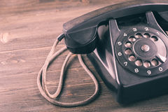 Old phone on wooden table closeup Stock Photos