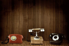 Old phones. Three classic old phones on grunge background royalty free stock photography