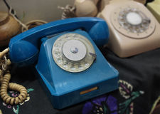 Old phones from a few decades ago. One blue while the other is light brown Royalty Free Stock Photo