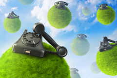Old phones on planets Stock Images