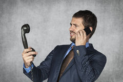 Old phones were very strange. Young man royalty free stock image