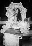Old photo. Young model dressed as a lady portraying the early days of the twentieth century Stock Photos