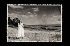 Old photo. Girl in communion dress Stock Photography