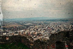 Old photo with aerial view of city Deva, Romania. Aerial view of the city of Deva, Romania, from the ruins of a citadel built in 1250 and located at an altitude Royalty Free Stock Images