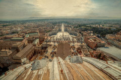 Old photo with aerial view from the cupola of Papal Basilica ove. R St. Peter`s Square in the Vatican City. Rome, Italy stock images