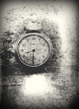 Old photo of the alarm clock - grained, scratched, overexposure Stock Photography