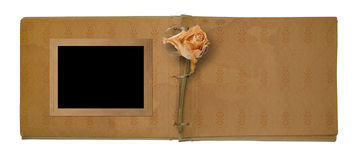 Old photo album with beautiful dried rose Stock Photography
