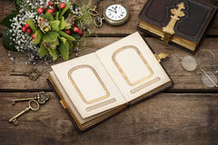 Old photo album over rustic wooden background Royalty Free Stock Photography