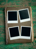 Old photo album on wooden background Royalty Free Stock Photography