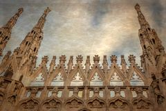 Old photo with architectonic details from the famous Milan Cathedral stock photography