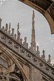 Old photo with architectonic details from roof of the Milan Cath Stock Photography