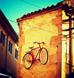 Old photo of bike on wall Stock Photos