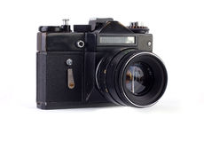 Old photo camera. Isolated on white background stock photos