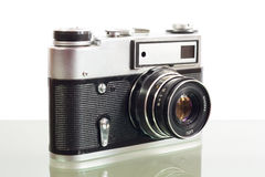 Old photo camera. On glass table.White background Stock Photography