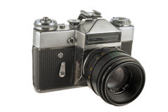 Old photo camera. Old photographic camera with lens close up Stock Photos