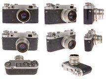 Old photo camera in eight position Stock Images