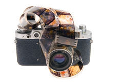 Old photo camera with film. On white background Royalty Free Stock Image