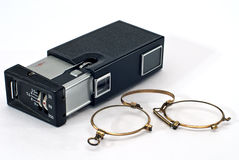 Old photo camera and glasses Royalty Free Stock Image