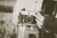 Old photo camera in a hands of girls. stock image