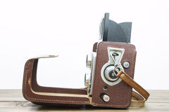 Old photo camera. In leather case on a wooden desk Stock Image