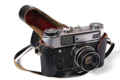 Old photo-camera with leather cover. Isolated on white background Royalty Free Stock Images