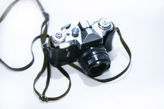 Old photo camera with lens. On white background Royalty Free Stock Images