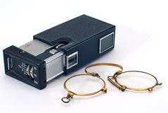 Old photo camera  and pince-nez Stock Photos