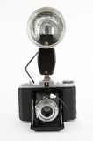 Old photo camera with strobe flash. On white background Stock Photos