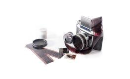 Old photo camera on white background. With analog films Stock Image