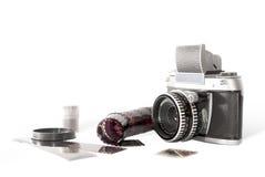 Old photo camera on white background. With analog films Stock Photo