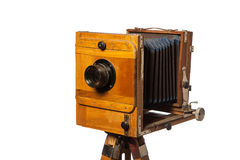 Old photo camera on white isolated background. Old camera closeup on a white isolated background Stock Photo