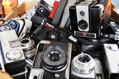 Old photo cameras. Box of old cameras in antique shop royalty free stock photography